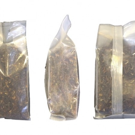 This is a back seam side gusseted quad bag showing 3 sides and it contains loose tea