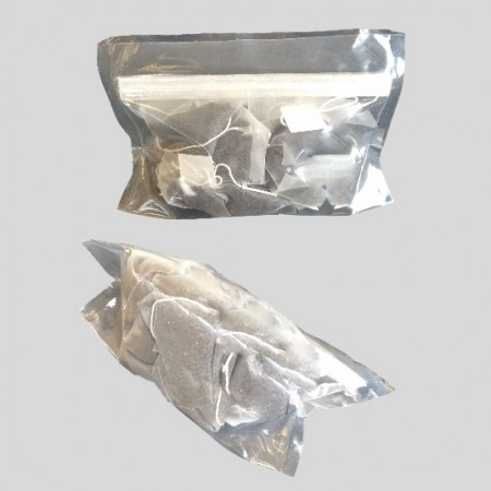 Stand up pouch with re-sealable gripper used for tea bags